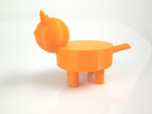 3D printed model of a cat with spherical head, triangular ears, and cylindrical legs, body and tail