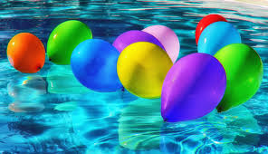 colourful balloons floating in a pool